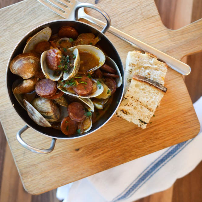 Sauteed chorizo and clams, one of the many tapas dishes on offer at Anchor & Den.